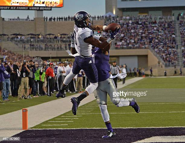 Wide receiver Josh Doctson of the TCU Horned Frogs catches a touchdown pass over defender Danzel McDaniel of the Kansas State Wildcats during the...