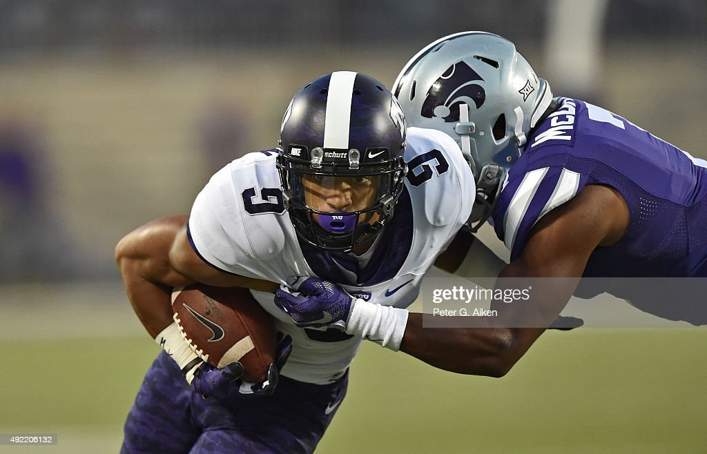 Wide receiver Josh Doctson #9 of the TCU Horned Frogs runs up field with the ball against defensive back Danzel McDaniel #7 of the Kansas State Wildcats during the first half on October 10, 2015 at Bill Snyder Family Stadium in Manhattan, Kansas.