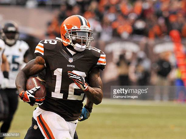 Wide receiver Josh Gordon of the Cleveland Browns carries the ball downfield for a touchdown during a game against the Jacksonville Jaguars on...
