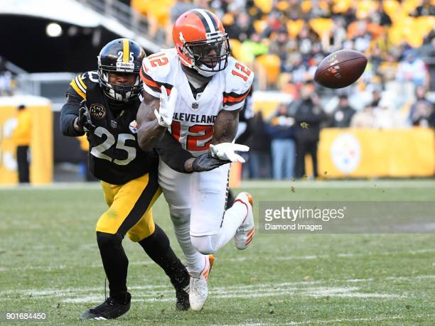 Wide receiver Josh Gordon of the Cleveland Browns catches a pass in front of cornerback Artie Burns of the Pittsburgh Steelers in the third quarter...