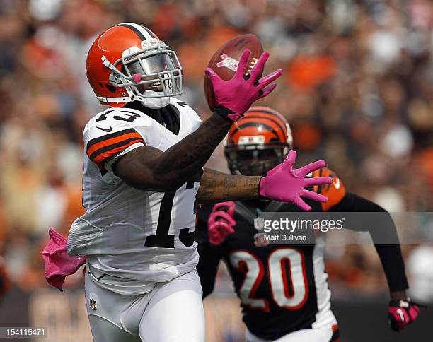 Wide receiver Josh Gordon of the Cleveland Browns catches a touchdown pass in front of safety Reggie Nelson of the Cincinnati Bengals at Cleveland...