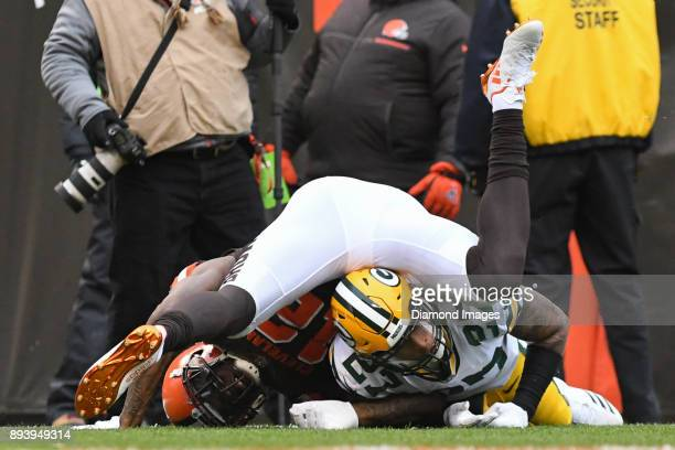 Wide receiver Josh Gordon of the Cleveland Browns falls on safety Josh Jones of the Green Bay Packers after attempting to catch a pass in the second...