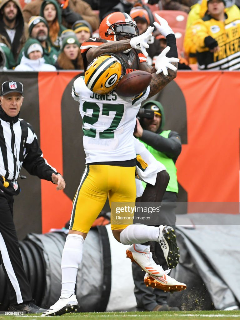 Wide receiver Josh Gordon #12 of the Cleveland Browns is contacted by safety Josh Jones #27 of the Green Bay Packers, as he attempts to catch a pass in the second quarter of a game on December 10, 2017 at FirstEnergy Stadium in Cleveland, Ohio. Green Bay won 27-21 in overtime.