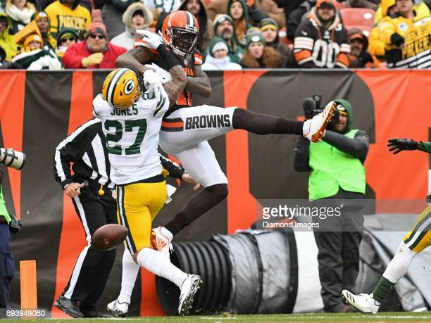 Wide receiver Josh Gordon of the Cleveland Browns is contacted by safety Josh Jones of the Green Bay Packers as he attempts to catch a pass in the...