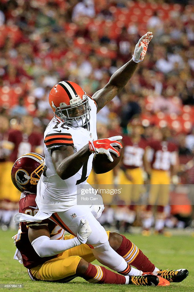 Wide receiver Josh Gordon #12 of the Cleveland Browns is tackled during a preseason game against the Washington Redskins at FedExField on August 18, 2014 in Landover, Maryland.