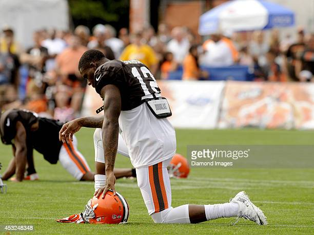 Wide receiver Josh Gordon of the Cleveland Browns kneels during stretching prior to a training camp practice on August 5 2014 at the Cleveland Browns...