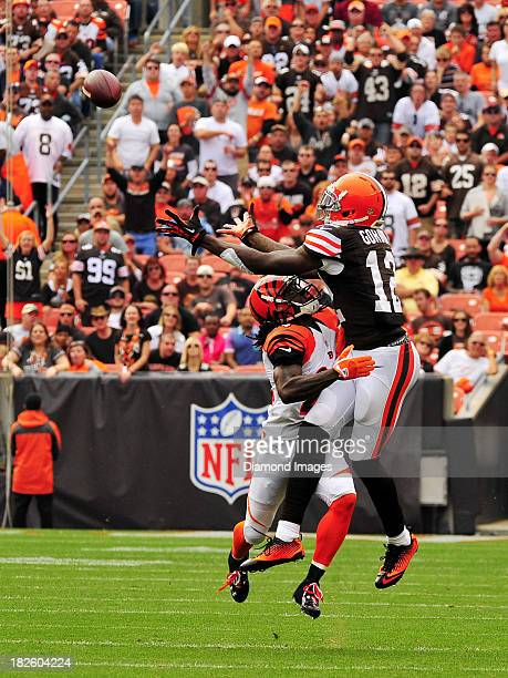Wide receiver Josh Gordon of the Cleveland Browns leaps over defensive back Adam Jones of the Cincinnati Bengals to catch a pass during a game on...
