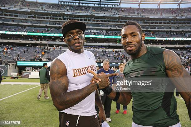 Wide Receiver Josh Gordon of the Cleveland Browns meets with Cornerback Antonio Cromartie of the New York Jets at MetLife Stadium on December 22 2013...