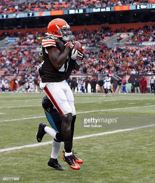 Wide receiver Josh Gordon of the Cleveland Browns scores a touchdown over cornerback Will Blackmon of the Jacksonville Jaguars at FirstEnergy Stadium...