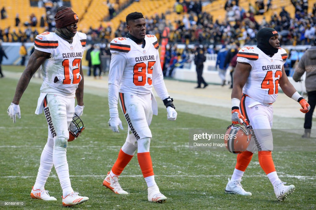 Wide receiver Josh Gordon #12, tight end David Njoku #85 and fullback Marquez Williams #42 of the Cleveland Browns walk off the field after a game on December 31, 2017 against the Pittsburgh Steelers at Heinz Field in Pittsburgh, Pennsylvania. Pittsburgh won 28-24. Cleveland became the second team in NFL history to finish a season 0-16.