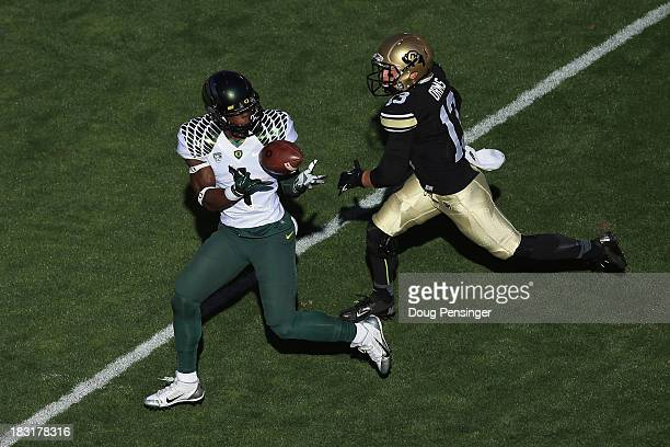 Wide receiver Josh Huff of the Oregon Ducks makes a 39 yard reception for a first down against defensive back Parker Orms of the Colorado Buffaloes...