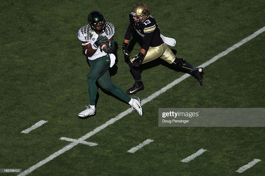 Wide receiver Josh Huff #1 of the Oregon Ducks makes a 39 yard reception for a first down against defensive back Parker Orms #13 of the Colorado Buffaloes in the first quarter at Folsom Field on October 5, 2013 in Boulder, Colorado. The Ducks defeated the Buffs 57-16.