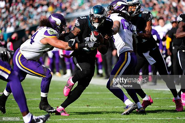 Wide receiver Josh Huff of the Philadelphia Eagles runs for yards against a pursuing middle linebacker Eric Kendricks of the Minnesota Vikings in the...