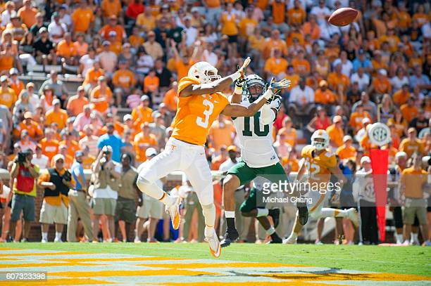 Wide receiver Josh Malone of the Tennessee Volunteers attempts to catch a pass in front of cornerback Randy Stites of the Ohio Bobcats at Neyland...