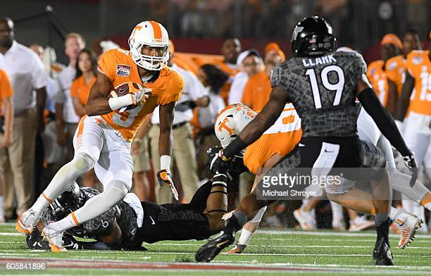 Wide receiver Josh Malone of the Tennessee Volunteers carries the ball following his reception against the Virginia Tech Hokies in the first half at...