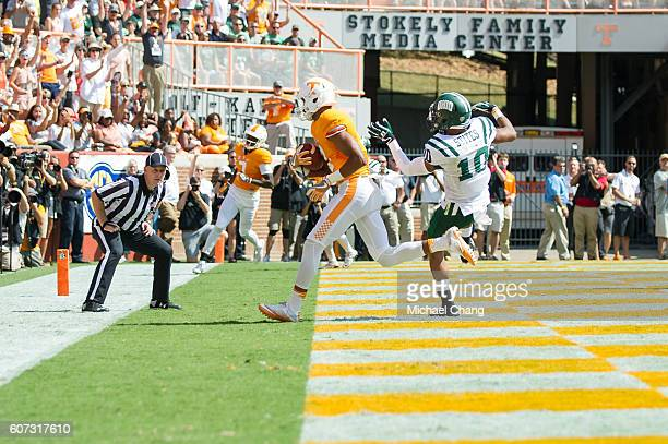 Wide receiver Josh Malone of the Tennessee Volunteers catches a pass in front of cornerback Randy Stites of the Ohio Bobcats for a touchdown at...
