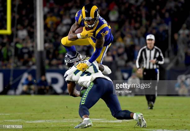 Wide receiver Josh Reynolds of the Los Angeles Rams leaps over defensive back Quandre Diggs of the Seattle Seahawks during the game at Los Angeles...