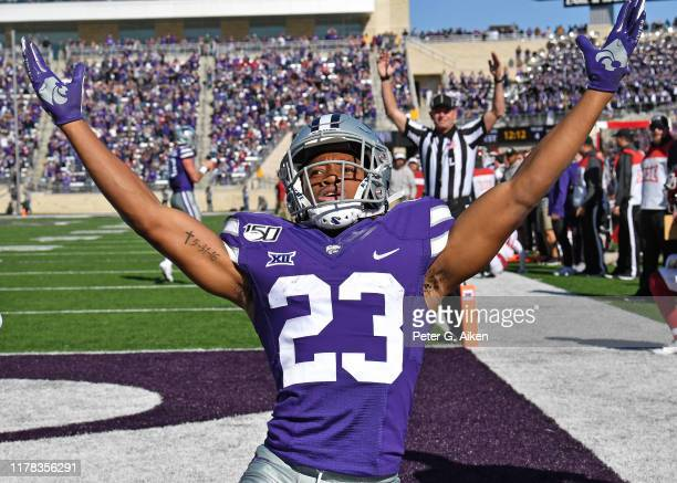 Wide receiver Joshua Youngblood of the Kansas State Wildcats reacts after scoring a touchdown against the Oklahoma Sooners during the first half at...