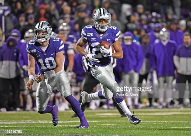Wide receiver Joshua Youngblood of the Kansas State Wildcats rushes up field against the Iowa State Cyclones during the second half at Bill Snyder...