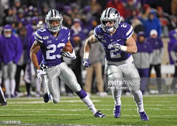 Wide receiver Joshua Youngblood of the Kansas State Wildcats turns up field behind running back Harry Trotter against the Iowa State Cyclones during...