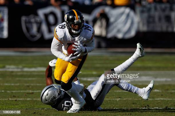 Wide receiver JuJu SmithSchuster of the Pittsburgh Steelers breaks a tackle from cornerback Daryl Worley of the Oakland Raiders during the second...