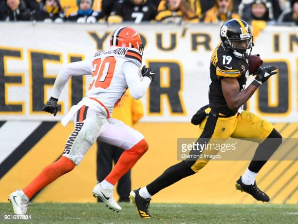 Wide receiver JuJu SmithSchuster of the Pittsburgh Steelers carries the ball downfield as he is pursued by cornerback Briean BoddyCalhoun of the...