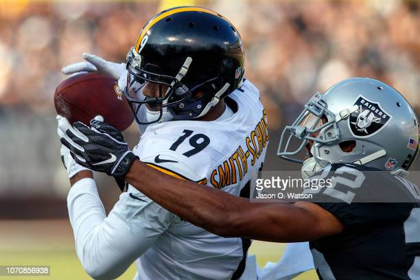 Wide receiver JuJu SmithSchuster of the Pittsburgh Steelers catches a pass in front of cornerback Rashaan Melvin of the Oakland Raiders during the...