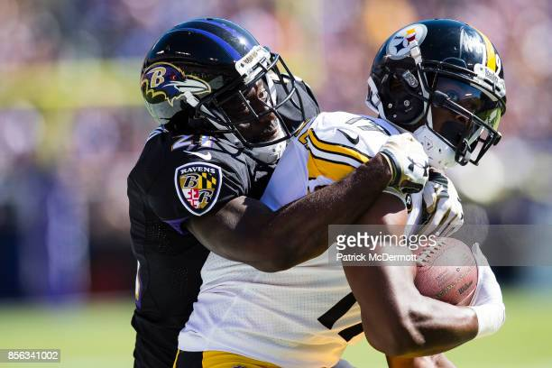 Wide receiver JuJu Smith-Schuster of the Pittsburgh Steelers is tackled by free safety Lardarius Webb of the Baltimore Ravens in the second quarter...
