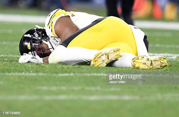 Wide receiver JuJu SmithSchuster of the Pittsburgh Steelers lies on the field after a hit by the defense of the Cleveland Browns during the second...