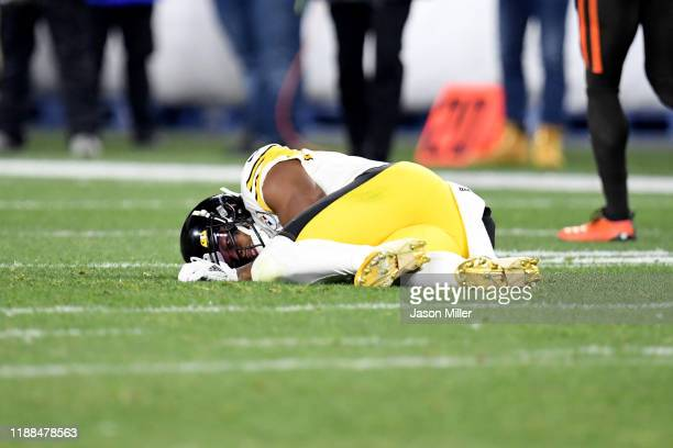 Wide receiver JuJu SmithSchuster of the Pittsburgh Steelers lies on the field after an injury during the second half against the Cleveland Browns at...