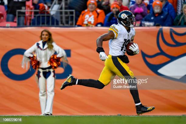 Wide receiver JuJu SmithSchuster of the Pittsburgh Steelers runs after a catch and scores on a 97 yard catch and run in the third quarter of a game...