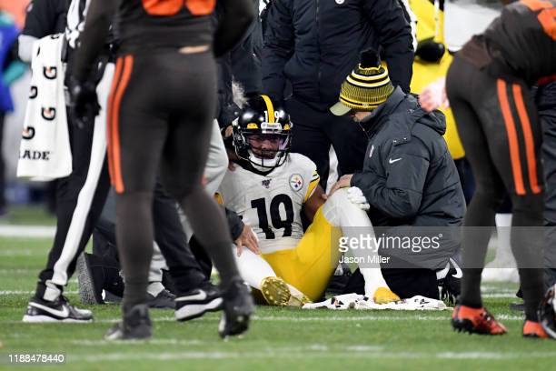 Wide receiver JuJu SmithSchuster of the Pittsburgh Steelers sits up after an injury during the second half against the Cleveland Browns at...