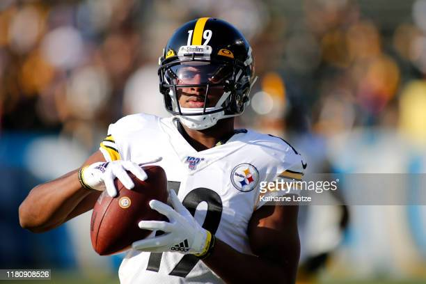 Wide receiver JuJu Smith-Schuster of the Pittsburgh Steelers warms up ahead of a game against the Los Angeles Chargers at Dignity Health Sports Park...