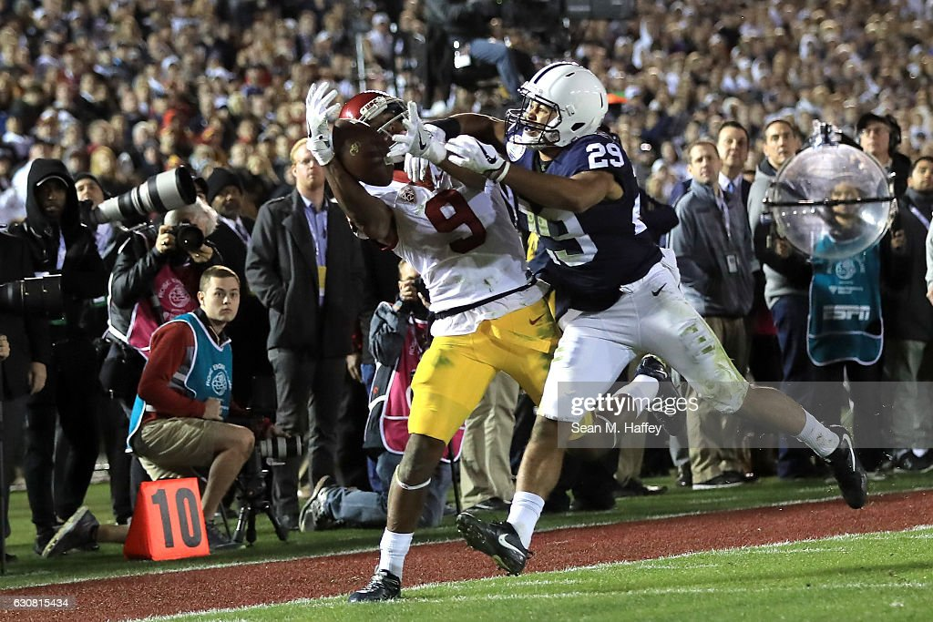 Wide receiver JuJu Smith-Schuster #9 of the USC Trojans makes a 22-yard catch against cornerback John Reid #29 of the Penn State Nittany Lions in the fourth quarter during the 2017 Rose Bowl Game presented by Northwestern Mutual at the Rose Bowl on January 2, 2017 in Pasadena, California.