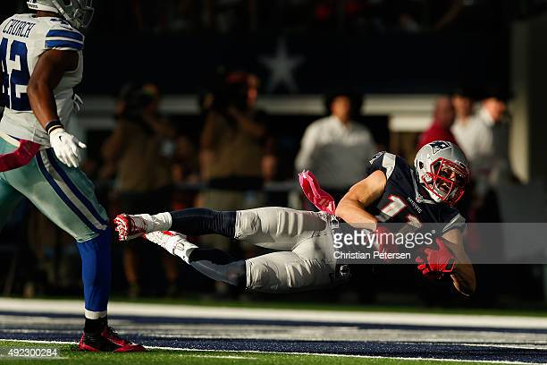Wide receiver Julian Edelman of the New England Patriots dives into the end zone to score on a 59 yard touchdown reception against the Dallas Cowboys...