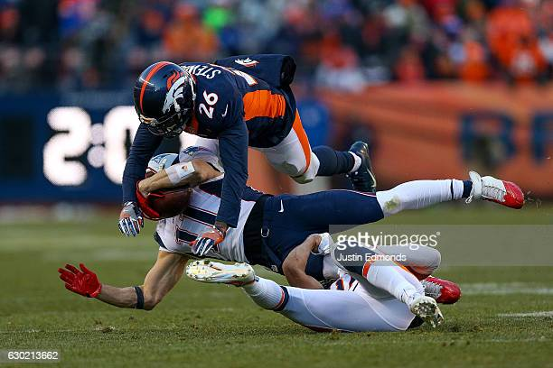 Wide receiver Julian Edelman of the New England Patriots has a reception for a first down and is hit by free safety Darian Stewart and strong safety...