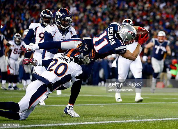Wide receiver Julian Edelman of the New England Patriots scores a touchdown in the fourth quarter against the Denver Broncos during a game at...