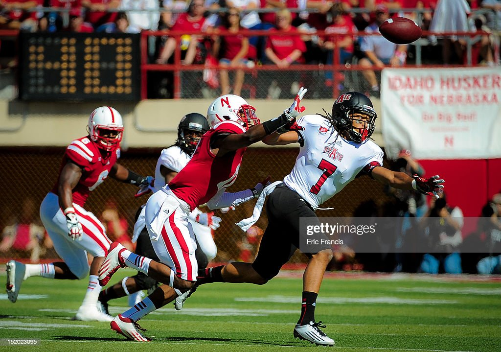 Wide receiver Julian Jones #7 of the Arkansas State Red Wolves and cornerback Ciante Evans #17 of the Nebraska Cornhuskers reaches for an overthrown pass during their game at Memorial Stadium on September 15, 2012 in Lincoln, Nebraska.
