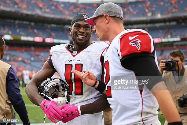 Wide receiver Julio Jones and quarterback Matt Ryan of the Atlanta Falcons talk after defeating the Denver Broncos 23-16 at Sports Authority Field at...