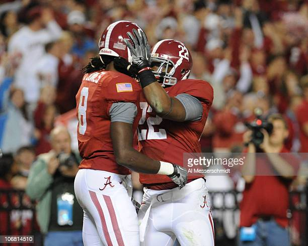 Wide receiver Julio Jones of the Alabama Crimson Tide celebrates a 56 yard touchdown with running back Mark Ingram against the Mississippi State...