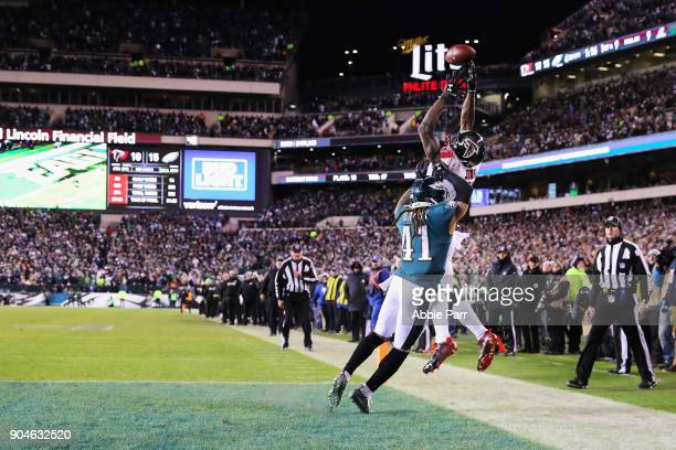 Wide receiver Julio Jones of the Atlanta Falcons attempts to make a catch against cornerback Ronald Darby of the Philadelphia Eagles during the...
