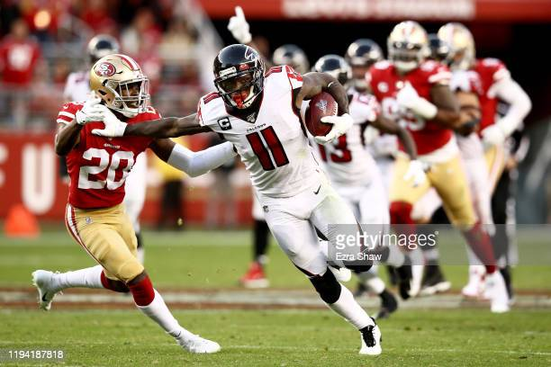 Wide receiver Julio Jones of the Atlanta Falcons carries the ball against free safety Jimmie Ward of the San Francisco 49ers during the game at...