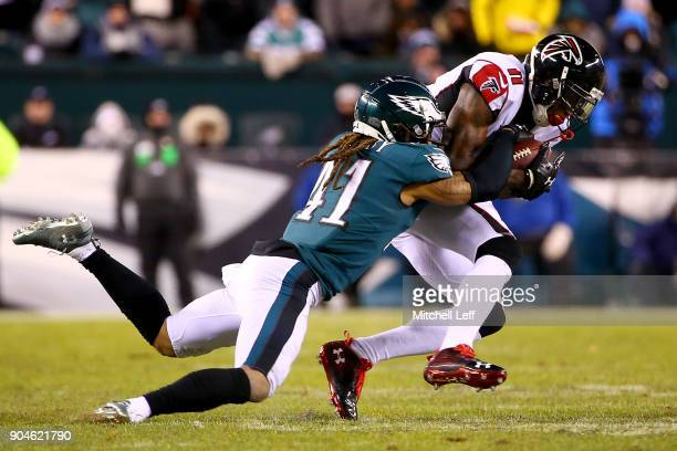 Wide receiver Julio Jones of the Atlanta Falcons catches a firstdown pass as he is tackled by cornerback Ronald Darby of the Philadelphia Eagles...