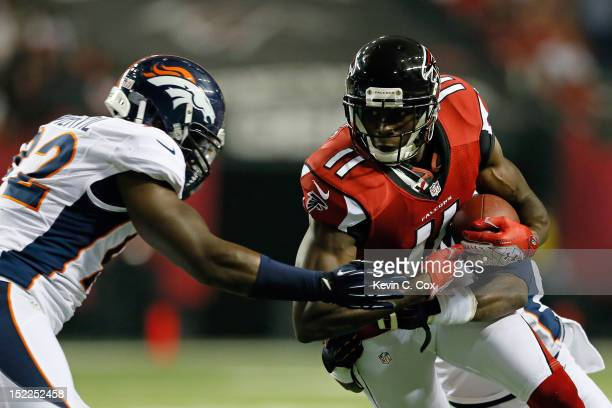 Wide receiver Julio Jones of the Atlanta Falcons catches a pass against defensive end Elvis Dumervil of the Denver Broncos during a game at the...