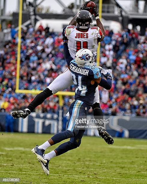 Wide receiver Julio Jones of the Atlanta Falcons jumps beyond the defense of Coty Sensabaugh of the Tennessee Titans to make a reception during the...