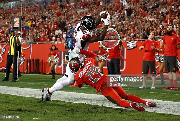 Wide receiver Julio Jones of the Atlanta Falcons keeps his feet in the end zone in front of cornerback Vernon Hargreaves of the Tampa Bay Buccaneers...