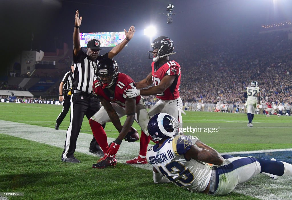 Wide receiver Julio Jones #11 of the Atlanta Falcons makes a touchdown catch in front of strong safety John Johnson #43 of the Los Angeles Rams as wide receiver Taylor Gabriel #18 celebrates during the fourth quarter of the NFC Wild Card Playoff game at Los Angeles Coliseum on January 6, 2018 in Los Angeles, California.