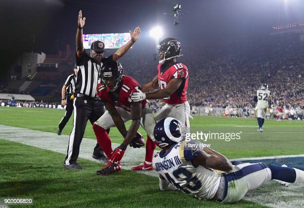 Wide receiver Julio Jones of the Atlanta Falcons makes a touchdown catch in front of strong safety John Johnson of the Los Angeles Rams as wide...