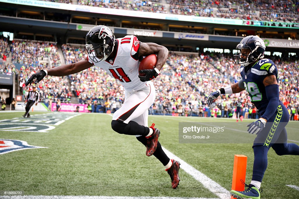 Wide receiver Julio Jones #11 of the Atlanta Falcons takes it in for a touchdown against the defense of free safety Earl Thomas #29 of the Seattle Seahawks at CenturyLink Field on October 16, 2016 in Seattle, Washington.