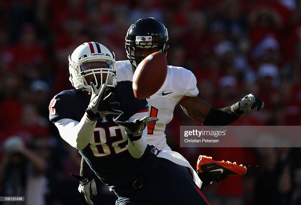 Wide receiver Juron Criner #82 of the Arizona Wildcats catches a 45 yard touchdown reception past James Dockery #4 of the Oregon State Beavers during the first quarter of the college football game at Arizona Stadium on October 9, 2010 in Tucson, Arizona.